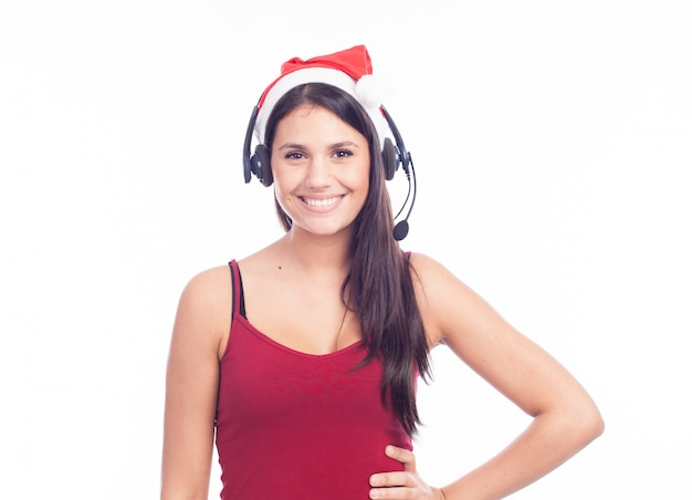 Christmas headset woman from telemarketing call center wearing red santa hat talking smiling isolated on white background.