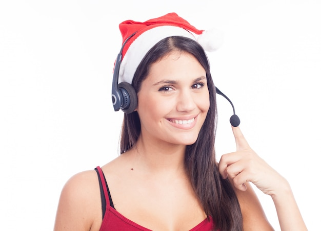 Christmas headset woman from telemarketing call center wearing red santa hat talking smiling isolated