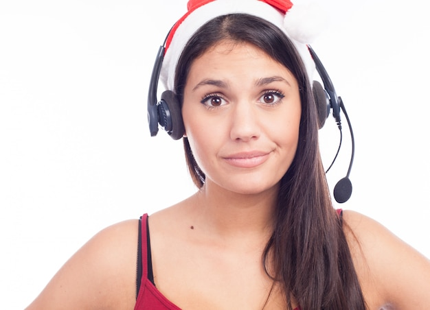 Christmas headset woman from telemarketing call center wearing red santa hat talking smiling