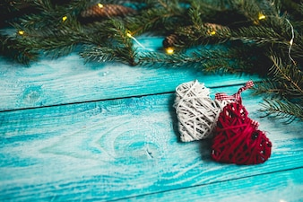Christmas hearts on a blue wooden table with Christmas tree. Mock up.