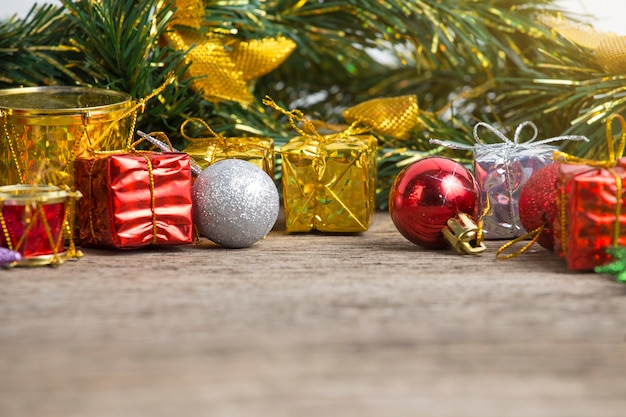 Christmas holiday background with empty wooden deck table over winter bokeh.