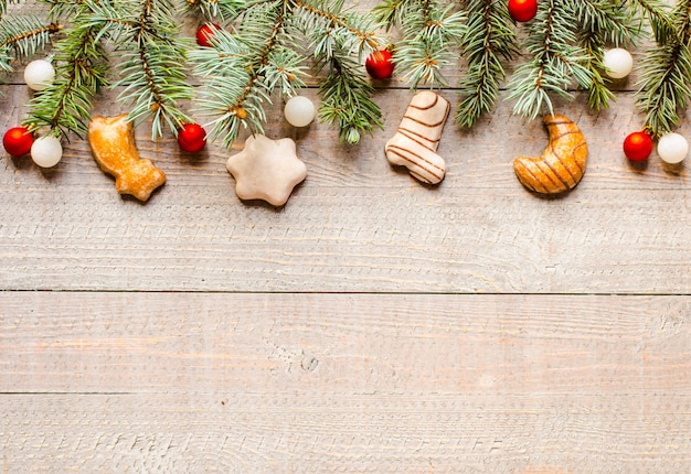 Christmas holiday background with ornaments on rustic wooden background.