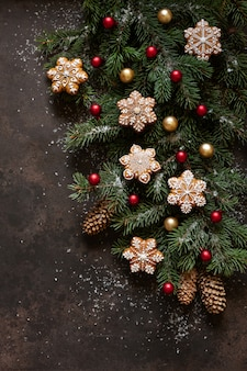 Christmas holiday composition with fir tree branches, cones, gingerbread and christmas decor