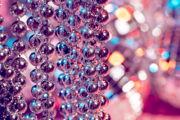Christmas and holiday decoration, close up of silver beads.