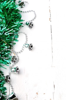 Christmas holiday decoration rustic  tinsel garland silver bells winter white wooden retro vintage