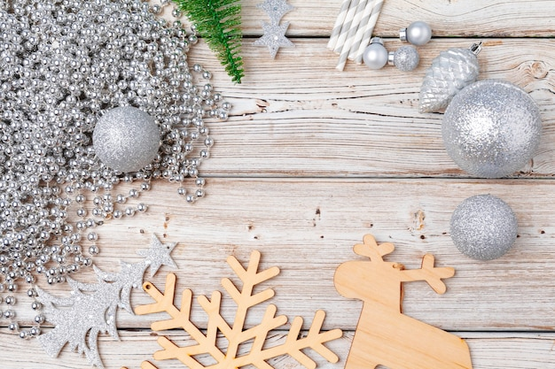 Christmas holiday decorations flatlay on light wooden background