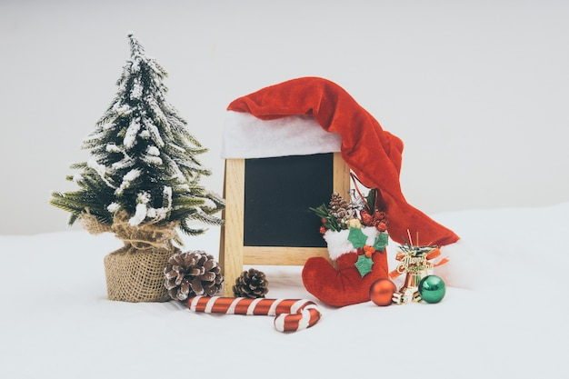 Christmas holiday decorations with blackboard on white background.