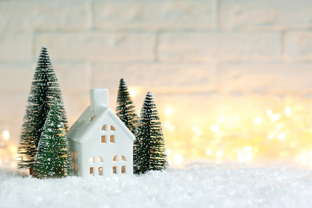 Christmas holiday decorative candlestick in the shape of a house