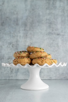 Christmas holiday donuts on a cake stand