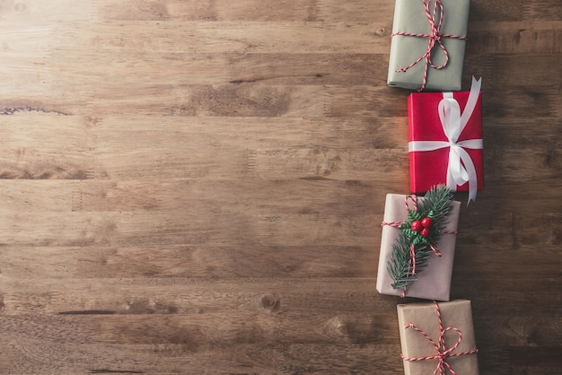 Christmas holiday gift boxes on wood table, border design  background