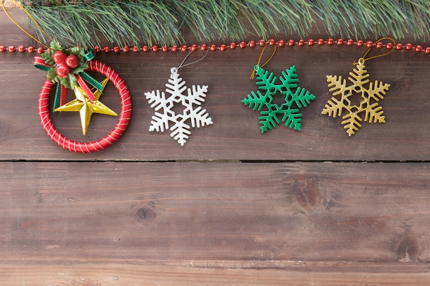Christmas and holiday season concept. top view of xmas ornament accessories and tree on old wooden plank with copy space.