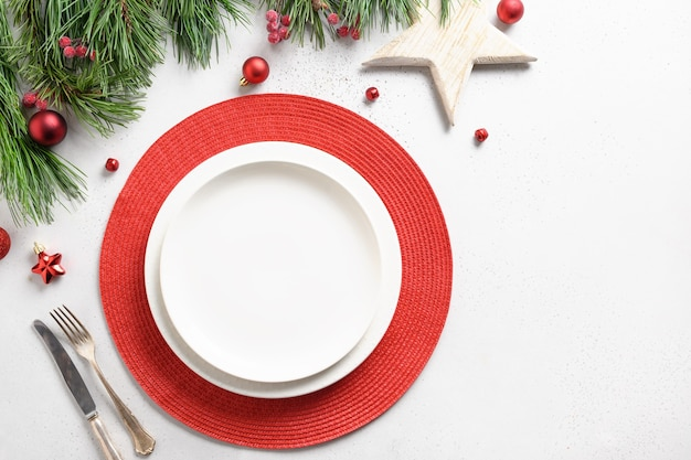 Christmas holiday table setting with white and red holiday decorations