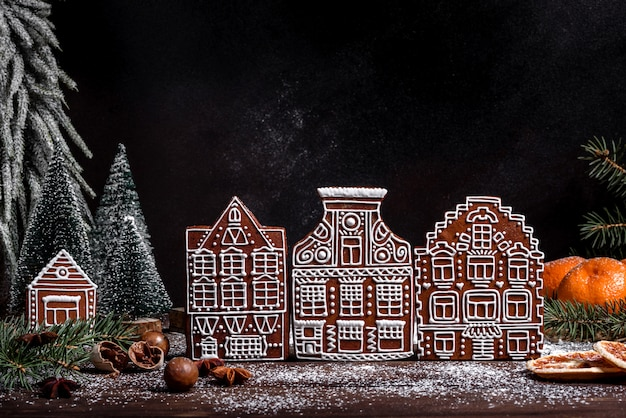 Christmas holiday table with delicious truffle cake and beautiful gingerbreads. festive mood on christmas eve
