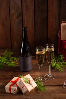 Christmas holiday table with glasses and a bottle and gifts