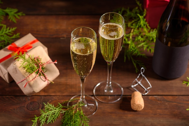 Christmas holiday table with glasses and a bottle of wine