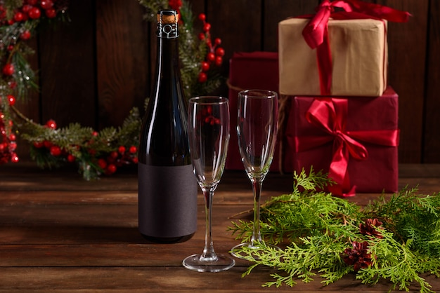 Christmas holiday table with glasses and a bottle
