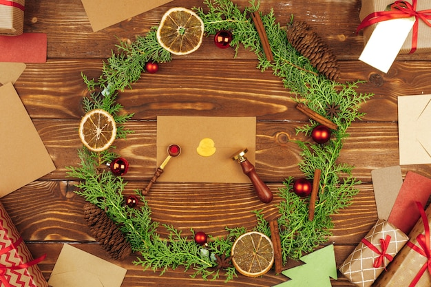 Christmas holiday wreath decoration on wooden background top view