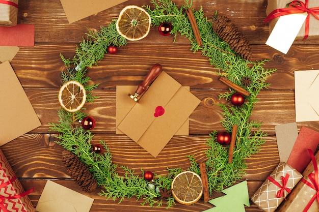 Christmas holiday wreath decoration on wooden background, top view
