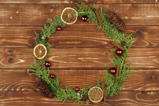 Christmas holiday wreath decoration on wooden , top view