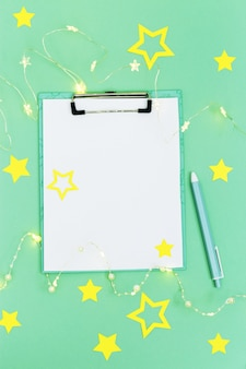 Christmas holidays concept, preparation for xmas, mock up white sheet for wish list