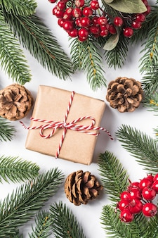 Christmas holidays zero waste paper gift box wrapping with tag, pine cones and fir branches