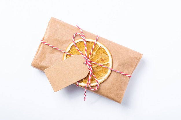 Christmas holidays zero waste paper gift wrapping with dried fruit and tag