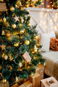 Christmas home decoration with christmas tree and gift boxes
