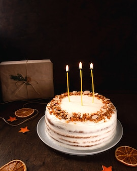 Christmas homemade cake, burning candles. close-up
