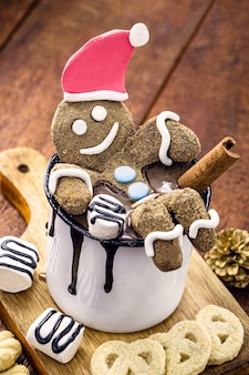 Christmas homemade gingerbread man, fun dessert with hot chocolate, happy christmas background