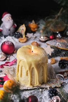 Christmas honey cake in the shape of a candle christmas atmosphere christmas tree christmas decorati