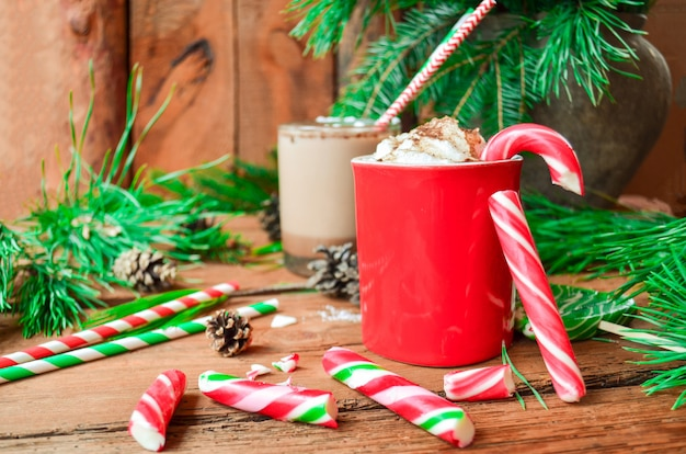 Christmas hot chocolate with candy. hot cocoa with candy canes. chocolate with whipped cream