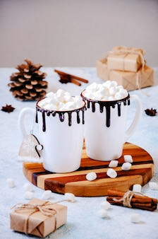 Christmas hot drink with marshmallows and gifts