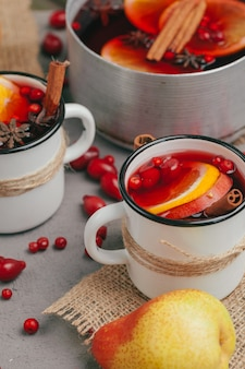 Christmas hot mulled wine in rustic cup close up