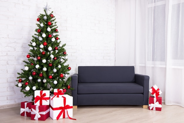 Christmas interior -decorated christmas tree and gifts in living room