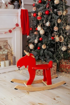 Christmas interior room with wooden elk rocking chair