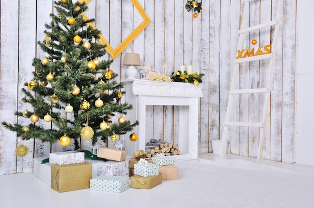 Christmas interior in white and gold color with christmas tree and gifts