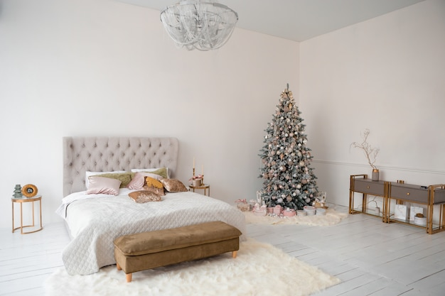 Christmas interior with christmas tree, gift boxes