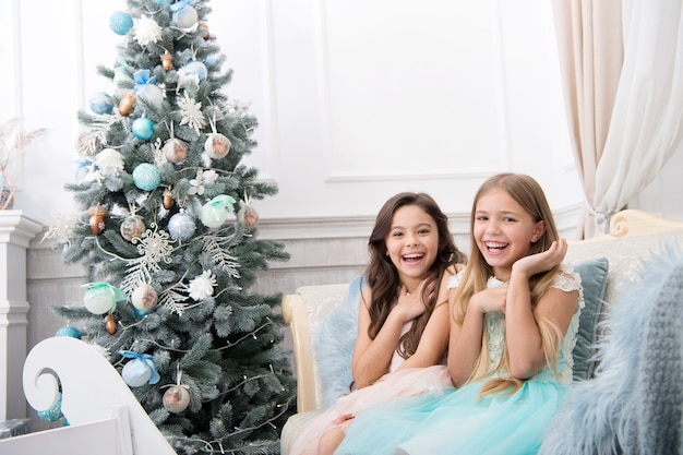 Christmas interior. xmas online shopping. family holiday. happy new year. winter. the morning before xmas. little girls. christmas tree and presents. child enjoy the holiday.
