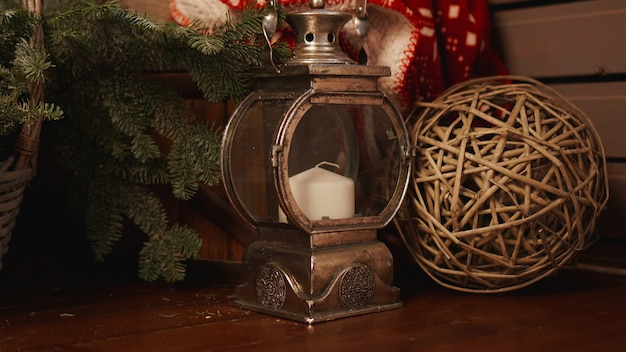 Christmas lantern on old wooden floor. lantern with christmas candle