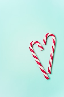 Christmas layout with candy cane laid out in the shape of a heart