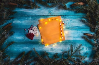 Christmas letter to Santa on a wooden blue table. Illuminated garland. Mock up.