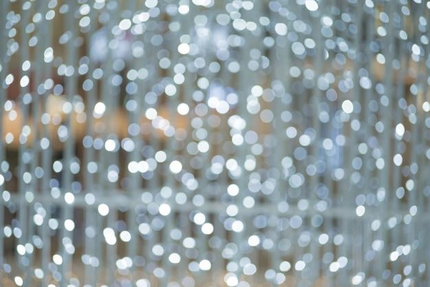 크리스마스 빛 배경입니다. 휴일 빛나는 배경. 깜박이 별 defocused 배경입니다. 흐리게 보케.