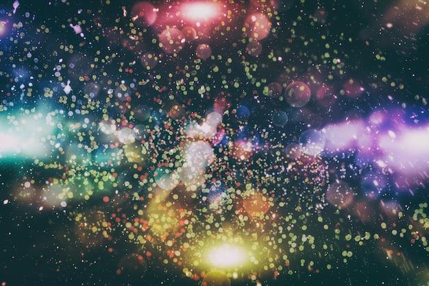 クリスマスライトの背景。休日の輝く背景。星が点滅している焦点がぼけた背景。ぼけボケ。