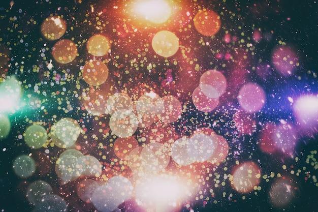 크리스마스 빛 배경입니다. 휴일 빛나는 배경. 깜박이는 별 defocused 배경입니다. 흐릿한 보케.