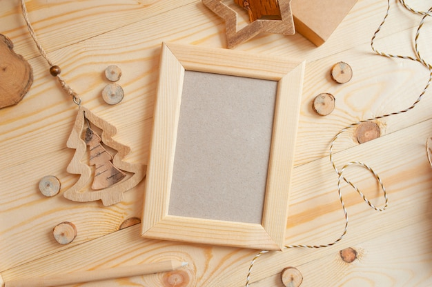 Christmas light wooden frame for photo on a wooden surface