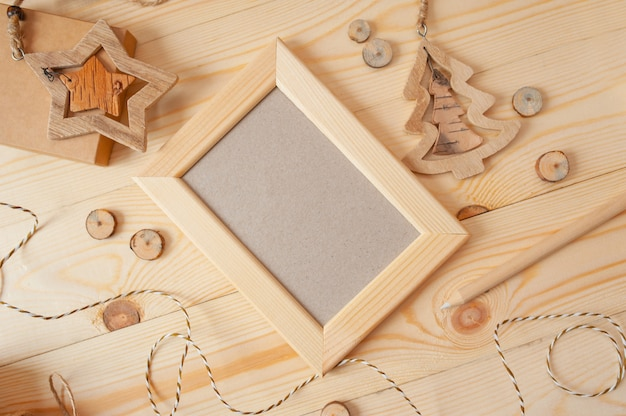 Christmas light wooden frame for photo on a wooden