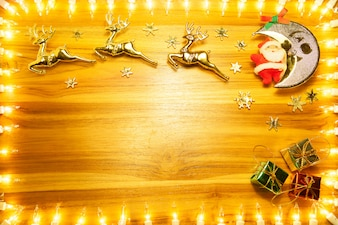 Christmas lights frame on golden wood background
