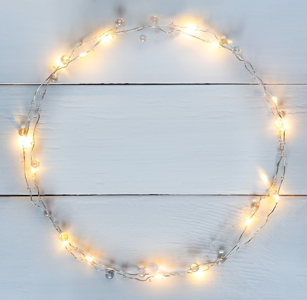 Christmas lights garland circular border with copy space.