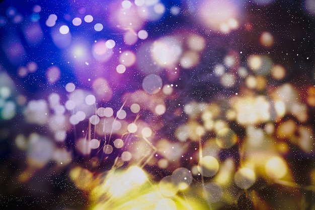 Christmas lights. gold holiday new year abstract glitter defocused background with blinking stars and sparks.