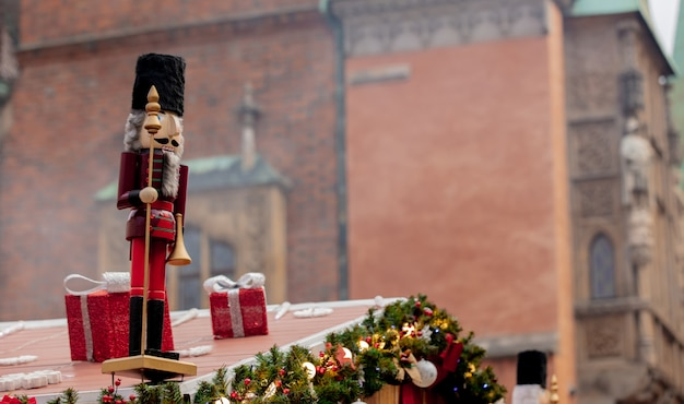 Christmas lights and nutcracker on roof in wroclaw, poland